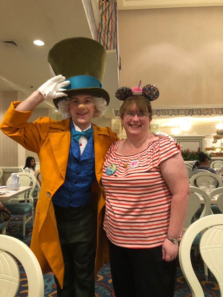 Auntie Catherine is telling everyone she is celebrating her birthday at Walt Disney World and is wearing her celebration button!