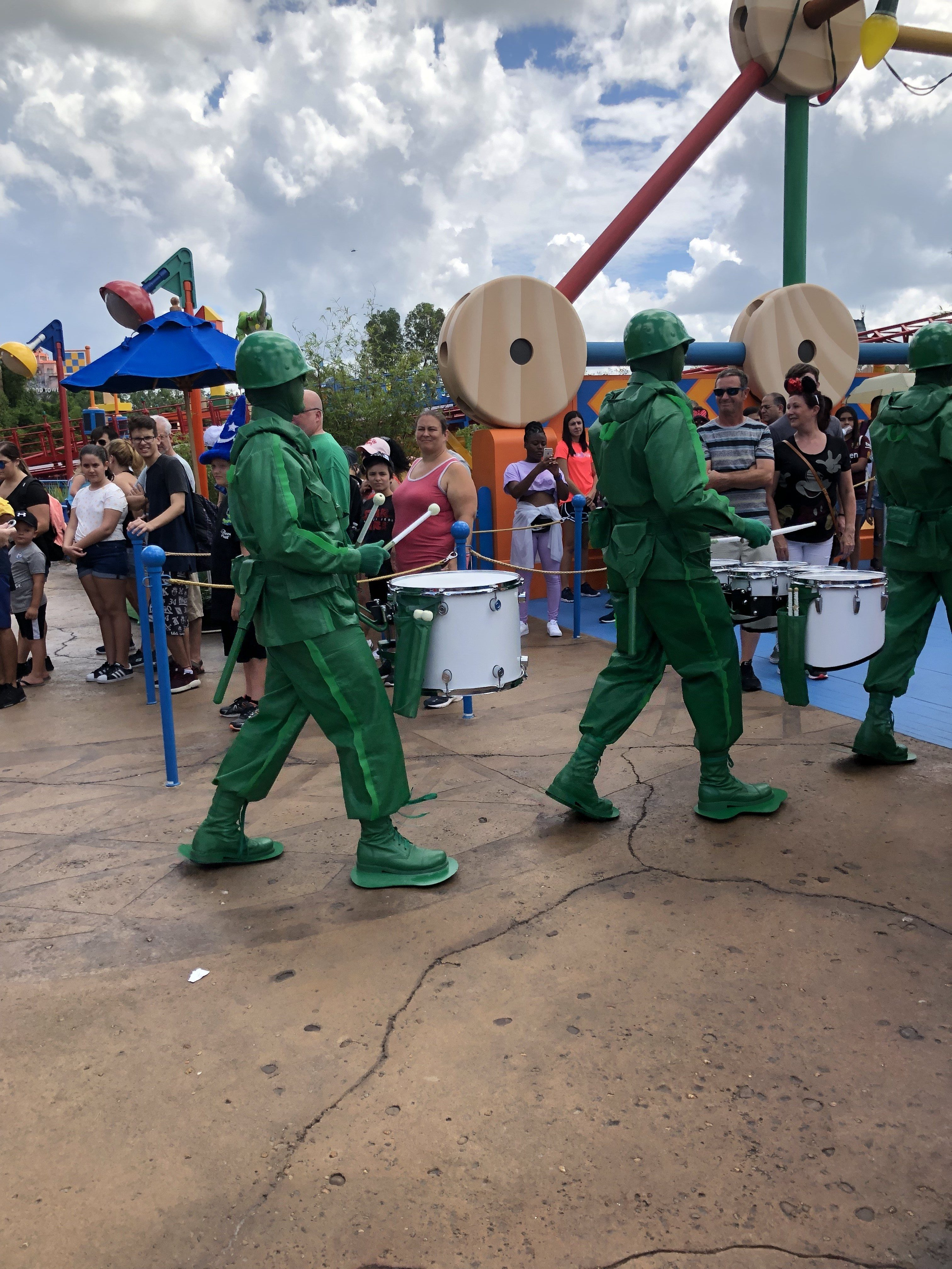 The Green Army Men marching through Toy Story Land