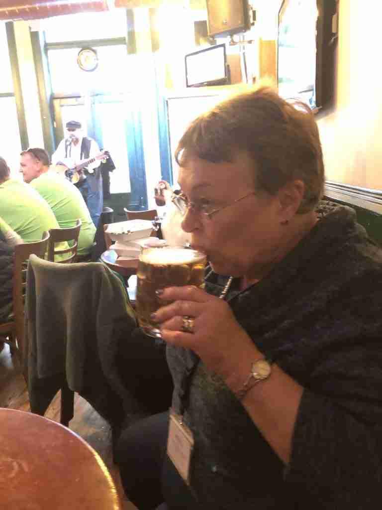 Grandma tasting the Moesehead Bear at Oleary's Pub Saint John