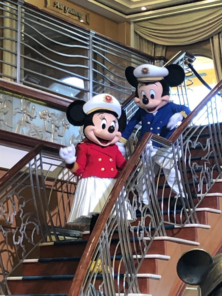 Mickey and Minnie welcome us on to the Disney Magic