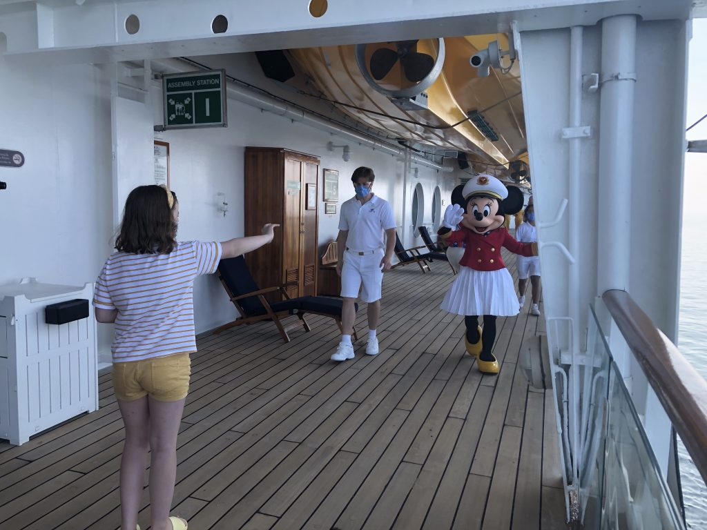 Minnie is socially meeting guests on the Disney Magic